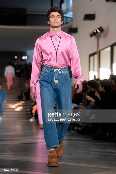 A model present a creation for fashion house MSGM during the Men's Fall/Winter 2019 fashion show in Milan on January 14 2018 / AFP PHOTO / Marco...
