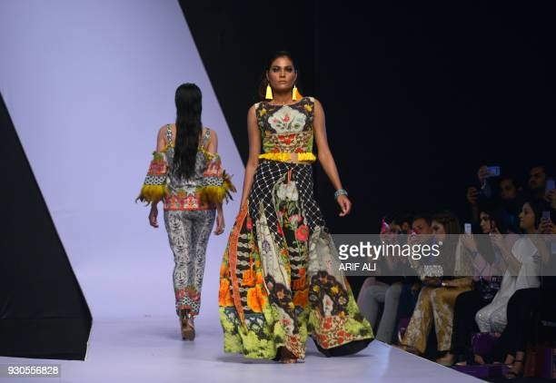 Model present creations by designer So kamal during the last day of the Pakistan Fashion Design Council Fashion Week in Lahore on March 11 2018 / AFP...