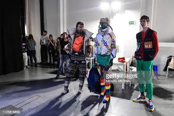 Model present creations by French fashion designer and Italian fashion house Benetton's new artistic director JeanCharles de Castelbajac on February...