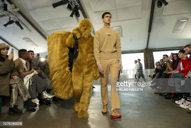 Model present creations during the Xander Zhou catwalk show on the second day of the Autumn/Winter 2019 London Fashion Week Men's fashion event in...