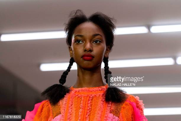 Model present creations from London-based Turkish designer Bora Aksu during a catwalk show for the Spring/Summer 2020 collection on the first day of...