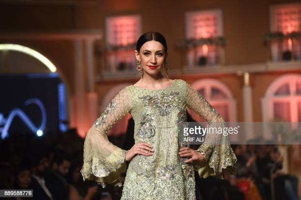 A model presenta a creation by designer Asifa and Nabeel on the last day of the Pantene Hum Bridal Couture Week in Lahore on December 10 2017 / AFP...