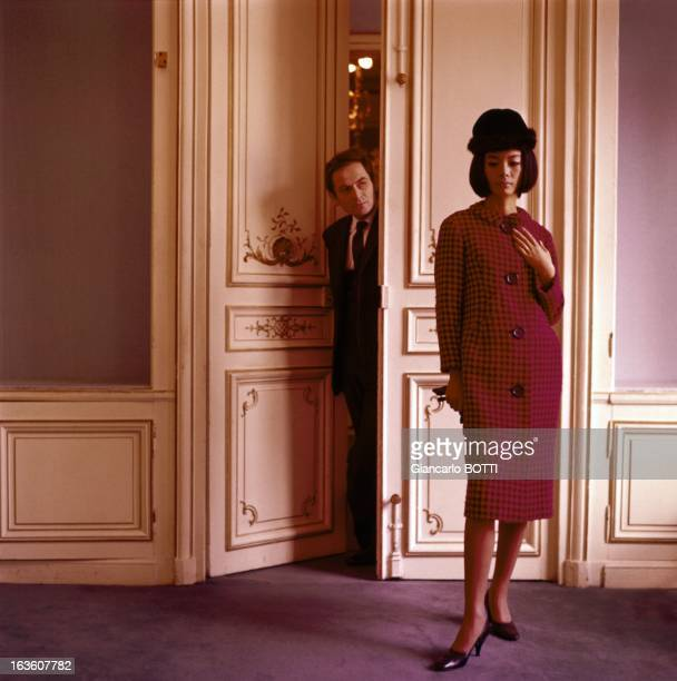 Model presenting a coat designed by French fashion designer Pierre Cardin circa 1960