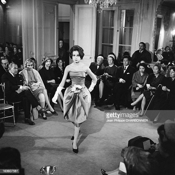 Model presenting a dress at a Pierre Cardin fashion show in 1958 in Paris France