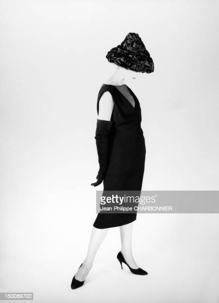 Model presenting a pencil dress 1959 in Paris France