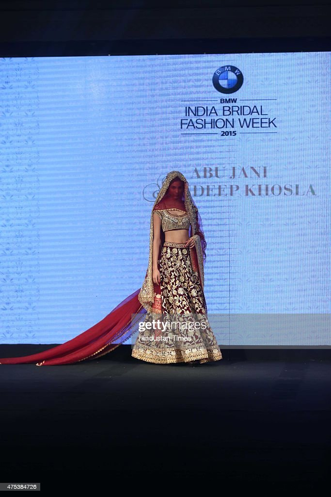 A model presenting the collection by designer duo Abu Sandeep during the launch of BMW India Bridal Fashion Week 2015 along with unveiling of the BMW.