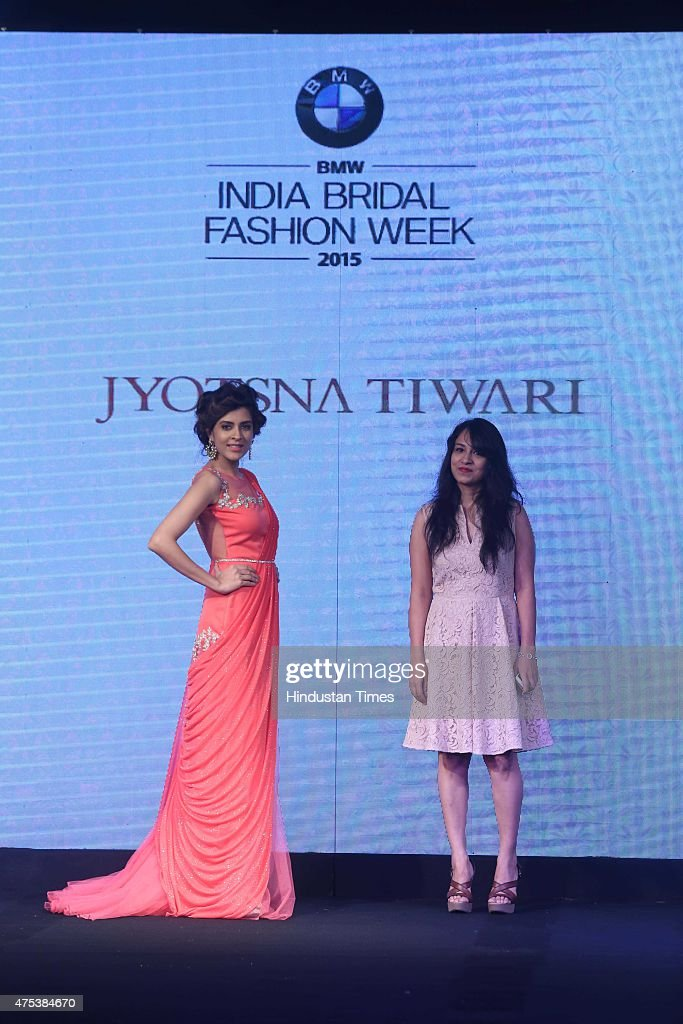 A model presenting the collection by designer Jyotsna Tiwari during the launch of BMW India Bridal Fashion Week 2015 along with unveiling of the BMW..