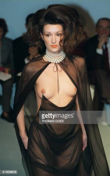 A model presents 17 January a black draped crepe georgette piercing evening gown worn with a silk chiffon cape during the presentation of Thierry...