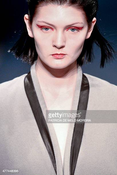 A model presents a Autumn/Winter 20142015 collection creation by Serbian fashion Designer Aleksandar Protic during the 42nd edition of Moda Lisboa...