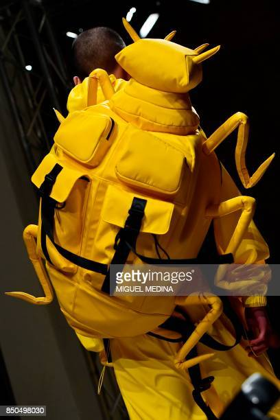 A model presents a backpack for fashion house Angel Chen during the Women's Spring/Summer 2018 fashion shows in Milan on September 20 2017