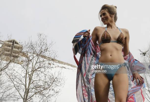 A model presents a bathing suit during a lingerie fashion show in the Lebanese ski resort of Faraya northeast of the capital Beirut on March 23 2019
