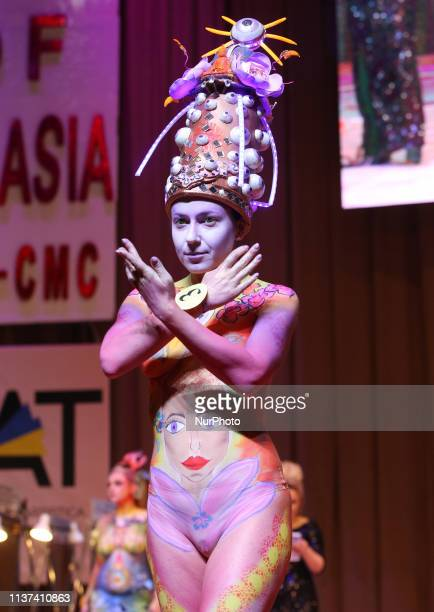 A model presents a body art creation during the annual international hairdressers festival 'Crystal Angel' in Kiev Ukraine 15 April 2019 Hairdressers...