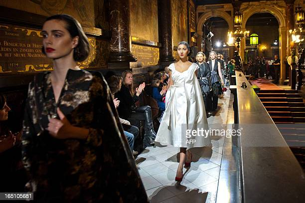 Model presents a bridal creation among other creations by Belgian fashion designer Tim Van Steenbergen during a fashion collection show in Antwerp on...