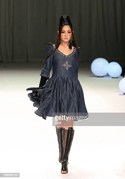 Model presents a Chinese fashion house Jason Wood Spring/Summer jeanswear collection at the China Fashion Week in Beijing on October 29, 2010. The...