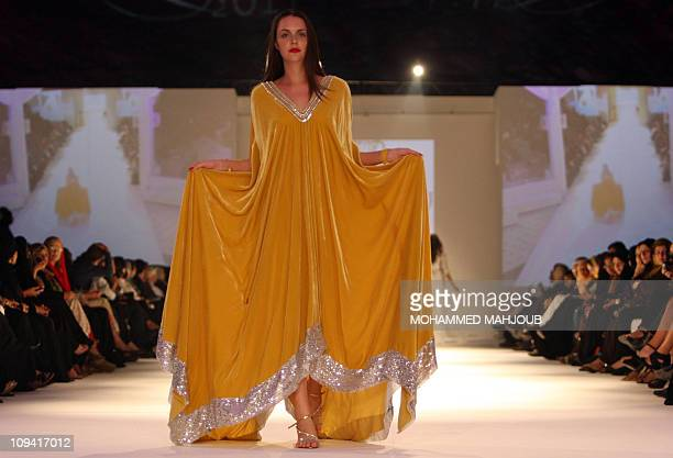 A model presents a classical creation by the Omani designers Dar Dibaj during the closing ceremony of the Muscat Fashion Week in the Omani capital...