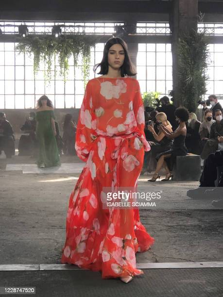 Model presents a collection for Valentino's Spring/Summer 2021 women's and men's collection during the Milan Fashion Week on September 27, 2020 in...