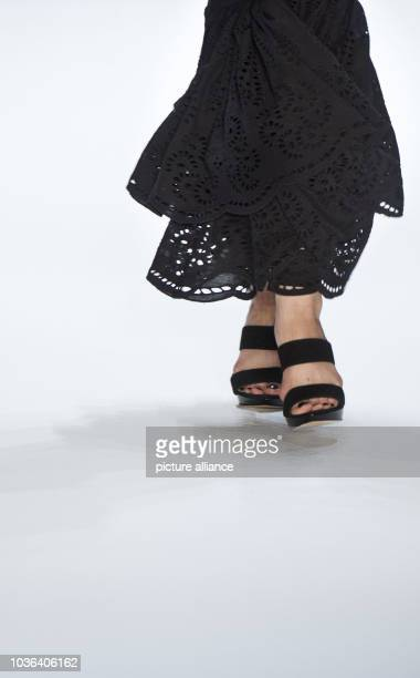 Model presents a creation at the Dimitri show during the Mercedes-Benz Fashion Week in Berlin, Germany, 03 July 2013. The presentations of the...