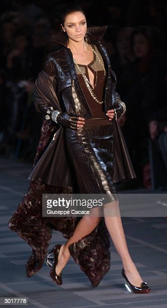 A model presents a creation at the Fendi Autumn/Winter 2004 collection during Milan Fashion Week February 26 2004 in Milan Italy