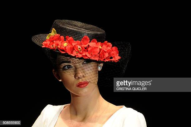A model presents a creation by a new designer Angeles Galvez during the SIMOF in Sevilla on February 5 2016 AFP PHOTO/ CRISTINA QUICLER / AFP /...