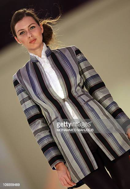 A model presents a creation by Afghan label Zarif Design during the 2011 Muscat Fashion Week in the Omani capital late on February 22 2011 AFP...