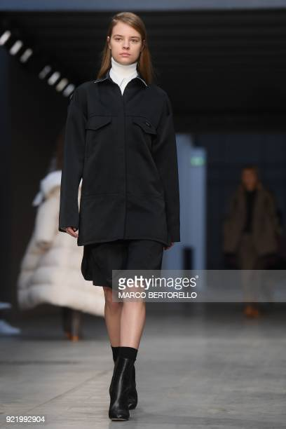 A model presents a creation by Albino Teodoro during the women's Fall/Winter 2018/2019 collection fashion show in Milan on February 21 2018 / AFP...