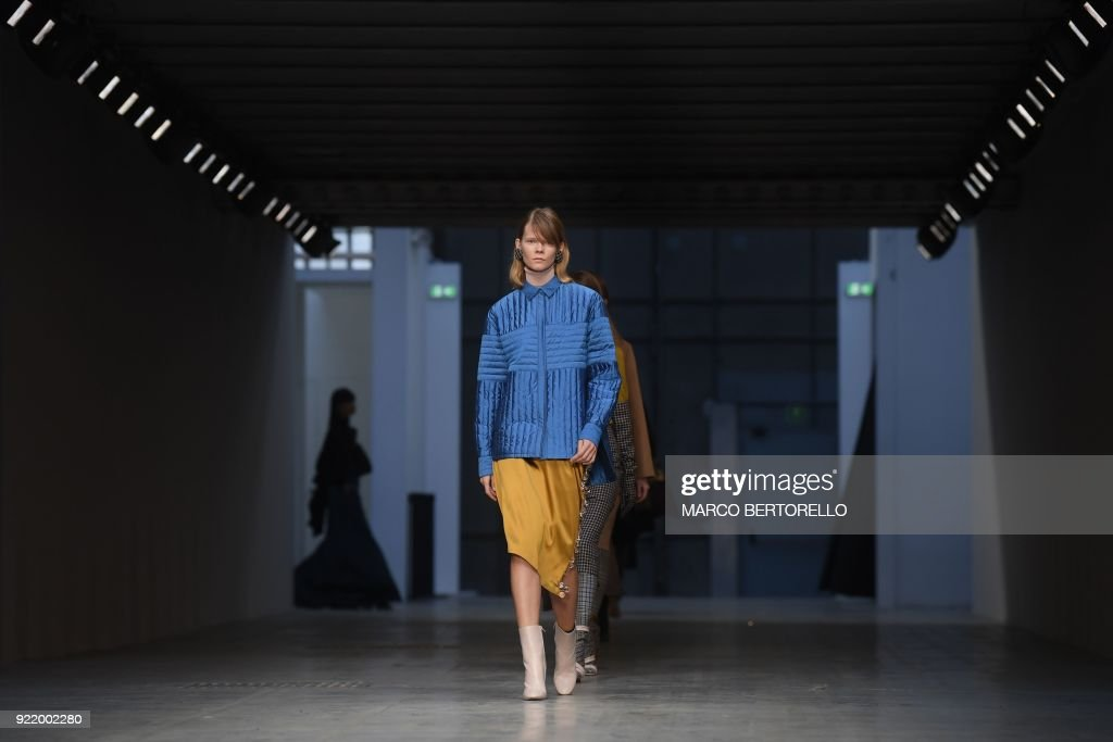 TOPSHOT - A model presents a creation by Albino Teodoro during the women's Fall/Winter 2018/2019 collection fashion show in Milan, on February 21, 2018. / AFP PHOTO / Marco BERTORELLO