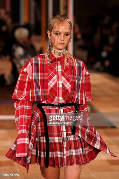 A model presents a creation by Alexander McQueen during the women's 2018 Spring/Summer readytowear collection fashion show in Paris on October 2 2017...