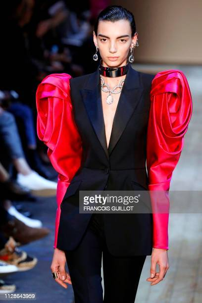 A model presents a creation by Alexander McQueen during the Women's FallWinter 2019/2020 ReadytoWear collection fashion show in Paris on March 4 2019