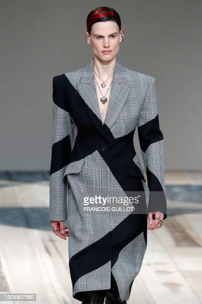 A model presents a creation by Alexander McQueen during the Women's FallWinter 20202021 ReadytoWear collection fashion show in Paris on March 2 2020