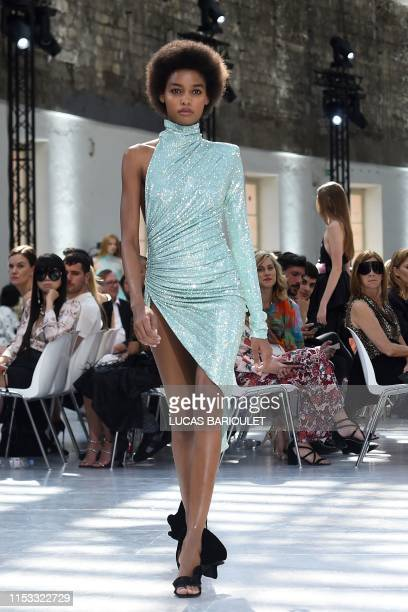 A model presents a creation by Alexandre Vauthier during the Women's FallWinter 2019/2020 Haute Couture collection fashion show in Paris on July 2...