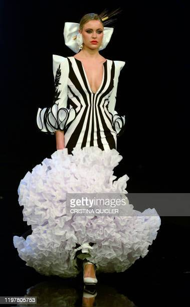 A model presents a creation by 'Ana Moron' during the Simof 2020 in Seville on January 31 2020