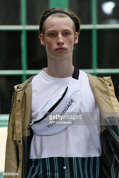 A model presents a creation by Andrea Crews house during men's Fashion Week for the Spring/Summer 2017/2018 collection in Paris on June 24 2017 / AFP...
