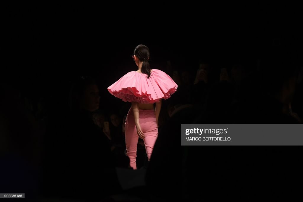TOPSHOT - A model presents a creation by Annakiki during the women's Fall/Winter 2018/2019 collection fashion show in Milan, on February 21, 2018. / AFP PHOTO / Marco BERTORELLO