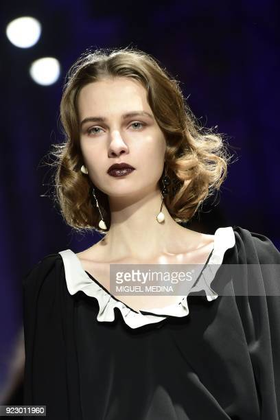 A model presents a creation by Anteprima during the women's Fall/Winter 2018/2019 collection fashion show in Milan on February 22 2018 / AFP PHOTO /...