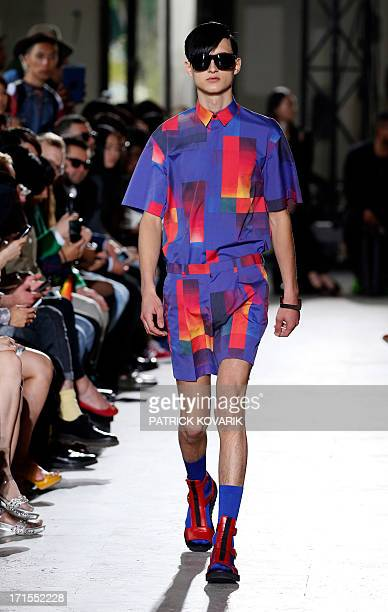 A model presents a creation by Arashi Yanagawa for John Lawrence Sullivan fashion house during the men's spring/summer 2014 readytowear fashion show...