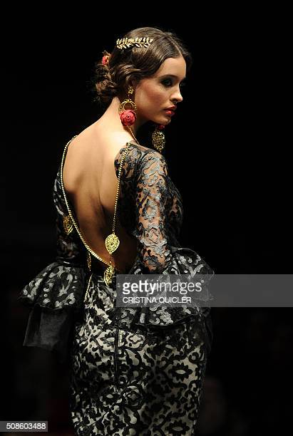 A model presents a creation by Arte y Compas during the SIMOF in Sevilla on February 5 2016 AFP PHOTO/ CRISTINA QUICLER / AFP / CRISTINA QUICLER