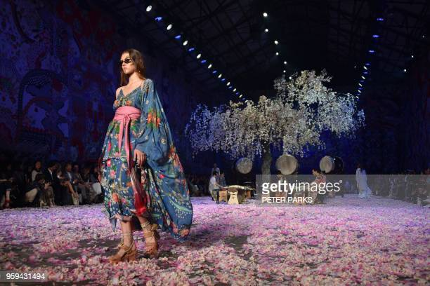 Model presents a creation by Australian designer Camilla during Fashion Week Australia in Sydney on May 17, 2018.