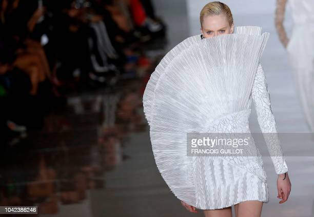 TOPSHOT A model presents a creation by Balmain during the SpringSummer 2019 ReadytoWear collection fashion show in Paris on September 28 2018