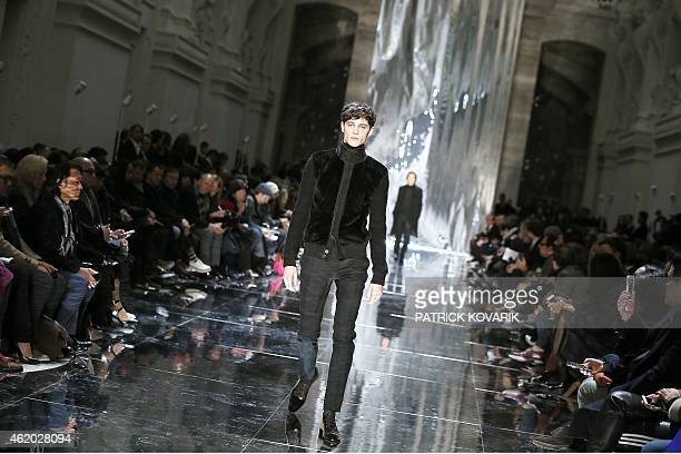 A model presents a creation by Berluti during the men's Fall/Winter 2015 readytowear collection fashion show in Paris on January 23 2015 AFP PHOTO /...