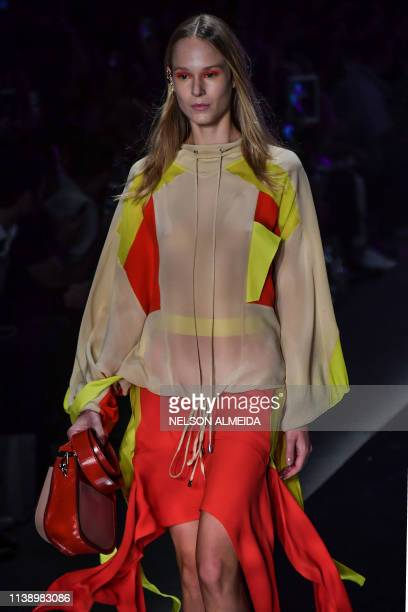 A model presents a creation by Bobstore during the Sao Paulo Fashion Week in Sao Paulo Brazil on April 23 2019
