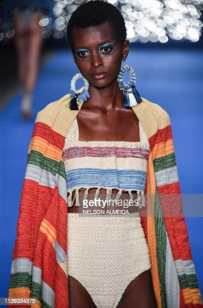 A model presents a creation by Borana during the Sao Paulo Fashion Week in Sao Paulo Brazil on April 25 2019