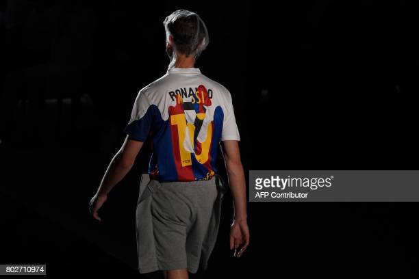 A model presents a creation by Braian Beast that mixes jerseys of Real Madrid's Portuguese forward Cristiano Ronaldo and Barcelona's Argentinian...