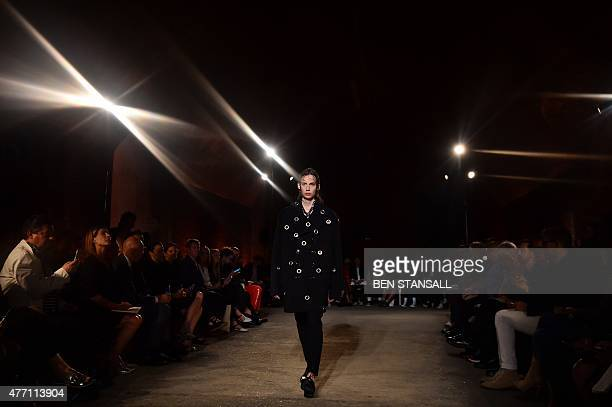A model presents a creation by British designer Alexander McQueen on the third day of the Spring/Summer 2016 London Collections Men fashion event in...