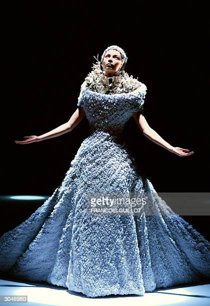 A model presents a creation by British designer Alexander McQueen during the presentation of Autumn/Winter 200405 collections at the Paris fashion...