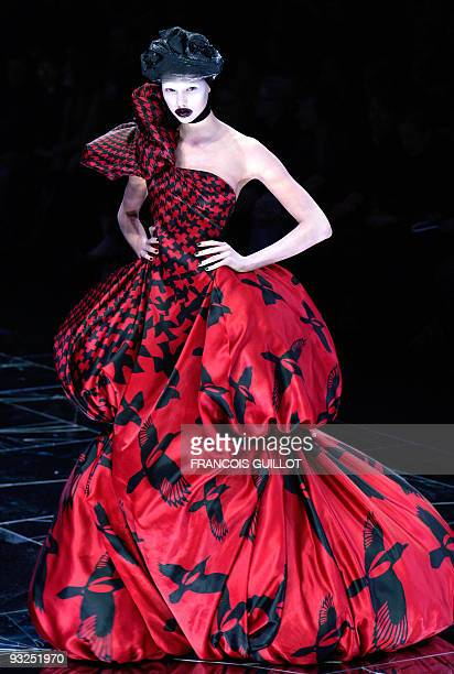 A model presents a creation by British designer Alexander McQueen during the autumn/winter 2009 readytowear collection show in Paris on March 10 2009...