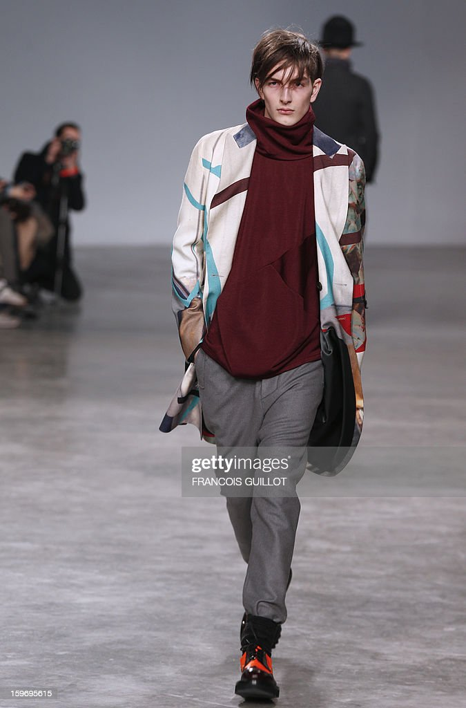 A model presents a creation by British designer Bill Gaytten for the label John Galliano during the men's Fall-Winter 2013-2014 collection show on January 18, 2013 as part of the Men's fashion week in Paris.