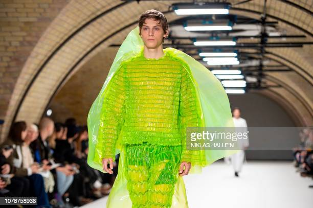 A model presents a creation by British designer Craig Green during their catwalk show on the final day of the Autumn/Winter 2019 London Fashion Week...