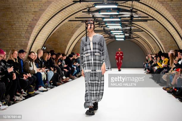 Model presents a creation by British designer Craig Green during their catwalk show on the final day of the Autumn/Winter 2019 London Fashion Week...