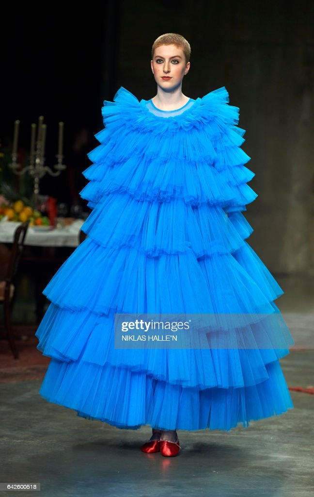 A model presents a creation by British designer Molly Goddard during a catwalk show on the second day of the Autumn/Winter 2017 London Fashion Week in London on February 18, 2017. / AFP / Niklas HALLE'N