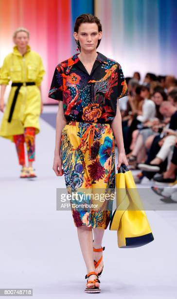 A model presents a creation by British designer Paul Smith during the Men's Fashion Week for the Spring and Summer 2018 collection in Paris on June...